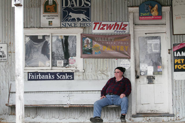 Ginn Grain Co. owner Bruce Kuck, of Quincy, takes a break, Tuesday, Feb. 20, from getting his business ready for the spring rush. Kuck was taking advantage of the warm weather to get his work done. Kuck sells animal feed for farm animals and house pets, a wide variety of candy, lawn and garden supplies, water softener and eggs. The Ginn Grain Co. is located on West North Street by the post office. The grain elevator was built in 1896 and was the first grain elevator in the state of Ohio to mix molasses with animal feed in the 1930's. Kuck bought the building in 1991.