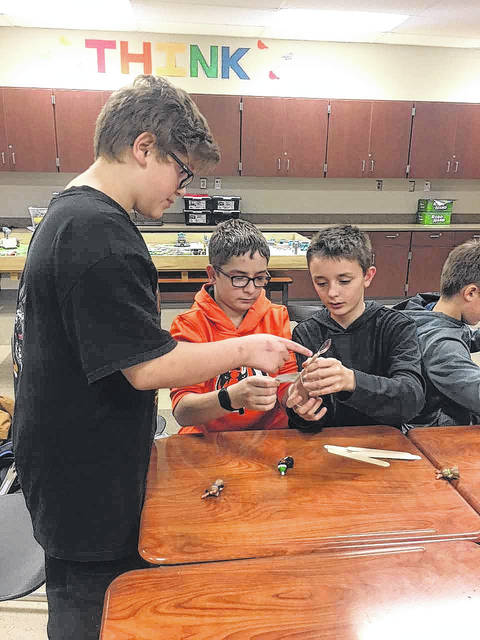 Houston Elementary students Gabe Foote, son of Kendra Calanchini; Kegan Brelsford, son of Jennifer and Randy Brelsford; and Gabe Dershem, son of Amber and Andrew Dershem, work together during the Manufacturing FUNdamentals course.
