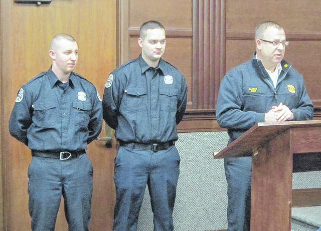Sidney Fire Chief Brad Jones, pictured on the right, presents Lucas Woodward, left, and Jordan Stemen, center, two of the department's three new firefighters, to Sidney City Council on Monday evening. The third new firefighter, Mitchell Ahlers, was unable to attend council's workshop session Monday.