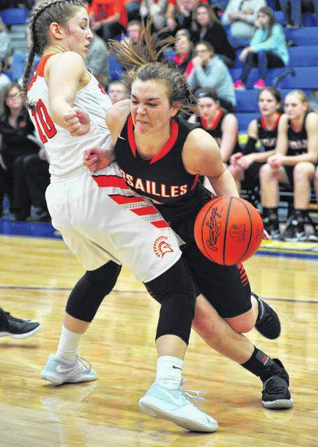 Versailles senior guard Kami McEldowney drives against a Waynesville defender during a Division III regional final on Saturday at Springfield.