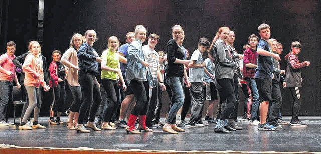 """The student cast of """"Anything Goes"""" rehearses a number at Versailles High School. The school will present the musical, April 5-7."""