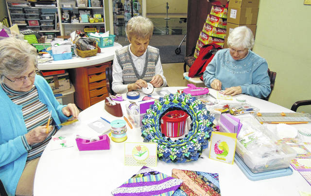 Marilyn McCarthy, left to right, Fran Brockman and Carol Prenger, all of Sidney, craft items for the upcoming Dorothy Love Crafters Bazaar at Ohio Living Dorothy Love recently.