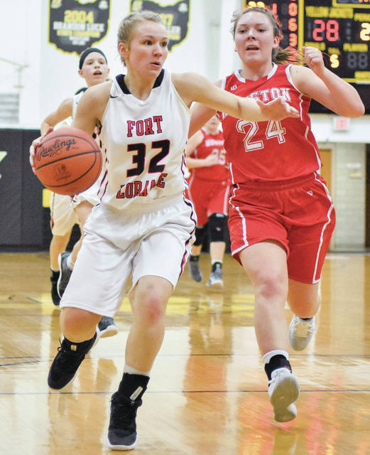 Fort Loramie senior point guard Hattie Meyer dribbles as Houston's Hayden Riesenbeck chases from behind during a Division IV sectional final on Saturday at Sidney. Fort Loramie plays Cedarville in a district final on Saturday.