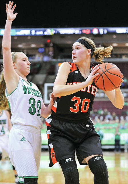 Courtney Prenger looks to pass with pressure from Waterford's Hayley Duff in the second half of a Division IV state semifinal on Thursday at the Schottenstein Center in Columbus.