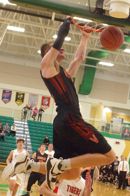Versailles senior Justin Ahrens dunks during a Division III sectional final at Northmont's Thunderdome on Saturday.