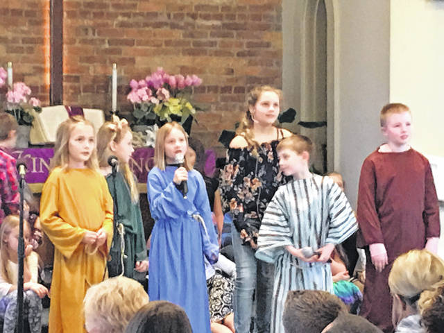 """The children from the Anna and Botkins United Methodist Churches performed """"It's All Because of Jesus"""" on Palm Sunday."""