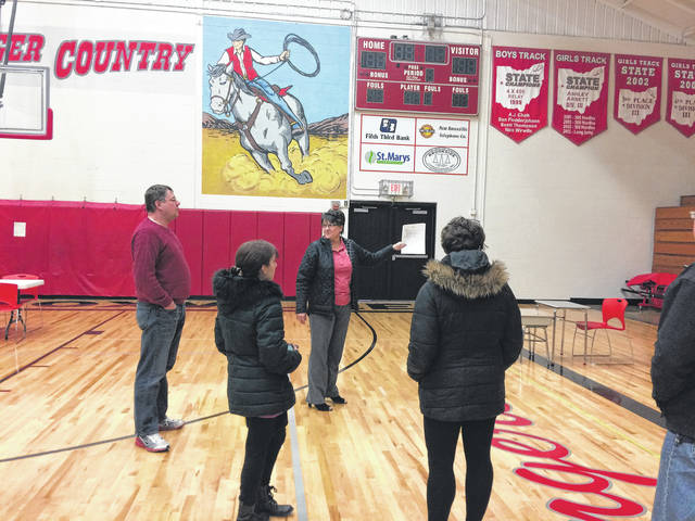 New Knoxville School Superintendent Kim Waterman and members of the board of education look at the gym as Waterman explains the need for an expansion at the school.