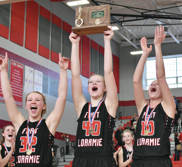 Celebrating their Division IV district championship win over Cedarville on Saturday at Troy are, left to right, Hattie Meyer, Abby Holthaus, and Heather Eilerman.