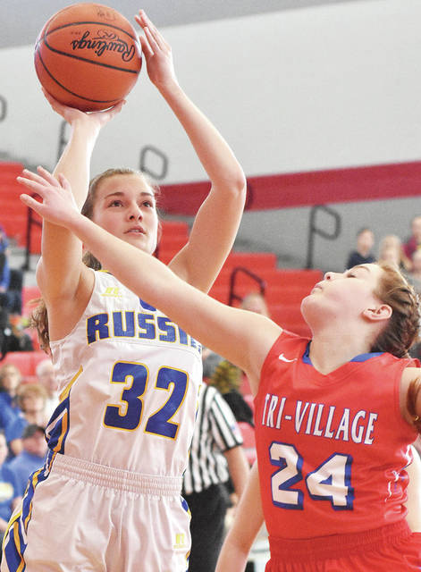 Russia's Jessica York shoots as Tri-Village's Andi Bietry defends during a Division IV district final on Saturday at Troy's Trojan Activities Center.