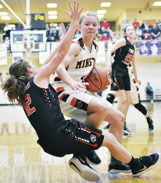 Minster's Ivy Wolf and Fort Loramie's Kennedi Gephart collide at Butler Saturday.