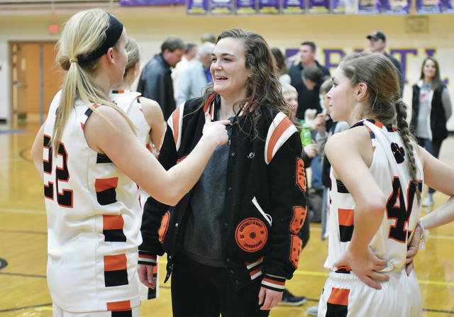 Talking after Minster regional final win over Fort Loramie last Saturday at Vandalia-Butler are, left to right, Minster's Jessica Falk, Versailles' Kami McEldowney and Minster's Janae Hoying. The trio will be in Columbus on Thursday as both Minster and Versailles' girls basketball teams play in state semifinals. The Wildcats will play Waterford at 3 p.m. at the Schottenstein Center on the campus of Ohio State, while Versailles will play for Elyria Catholic at 6.