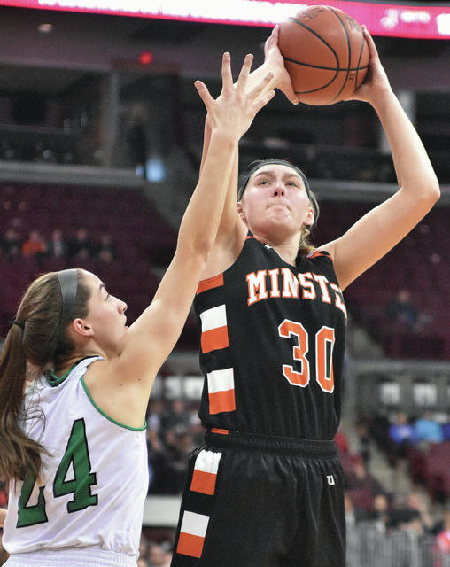 Minster's Courtney Prenger shoots as Waterford's Megan Ball defends during a Division IV state semifinal last Thursday at the Schottenstein Center in Columbus. Prenger, a junior forward, is one of four area players who will participate in the Bill Moss Memorial Underclass all-star game on Wednesday at Edison State in Piqua.
