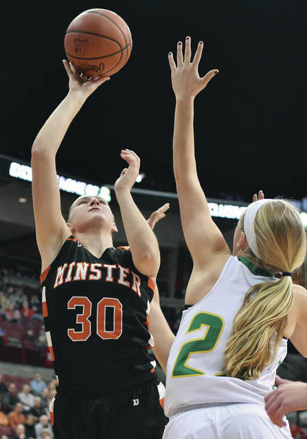 Minster's Courtney Prenger shoots with pressure from Ottoville's Amber Miller at the Schottenstein Center in Columbus Saturday.