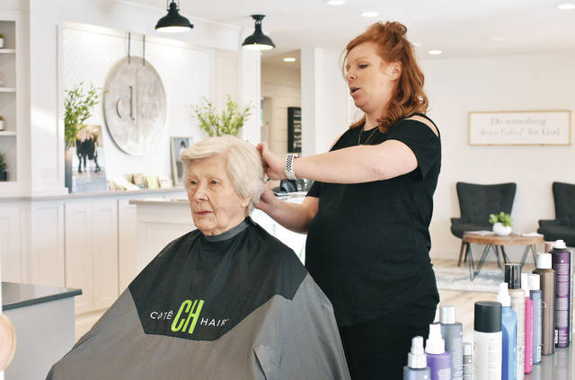 Mary Schmiesing, left, has her hair styled by her granddaughter, Danae Hoying, both of Minster, at Hoying's new beauty parlor, Tuesday, March 20. Danae's 4th Street Salon is at 234 E. 4th St., Minster.