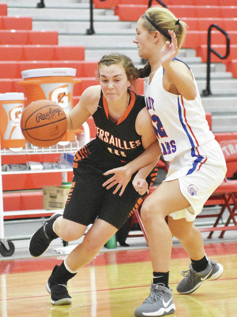 Versailles' Kami McEldowney drives during the first half of the District Nine Div. I/II/III girls all-star game on Thursday at Troy's Trojan Activities Center.