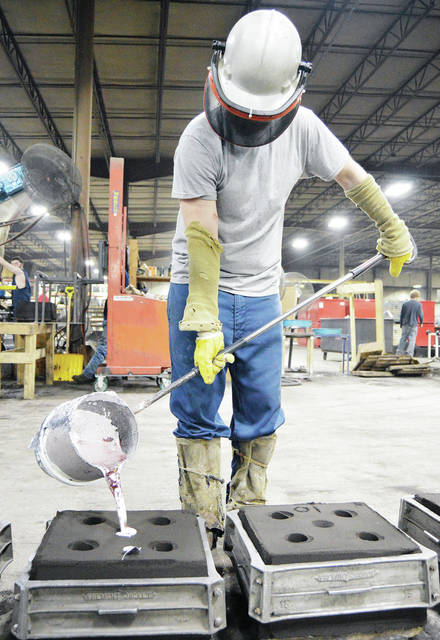Cody Shafer, of Bradford, pours molten aluminum into a mold at Francis Manufacturing, Thursday, March 29.