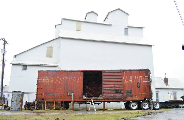 The Western Maryland Railroad freight car which has been a Sidney landmark behind the Ginn Grain Co. for years waits on top newly placed tires, Thursday, March 29, to be driven to Western Maryland Scenic Railroad in Cumberland, Md. The freight car was sold by Ginn Grain Co. owner Bruce Kuck, of Quincy.