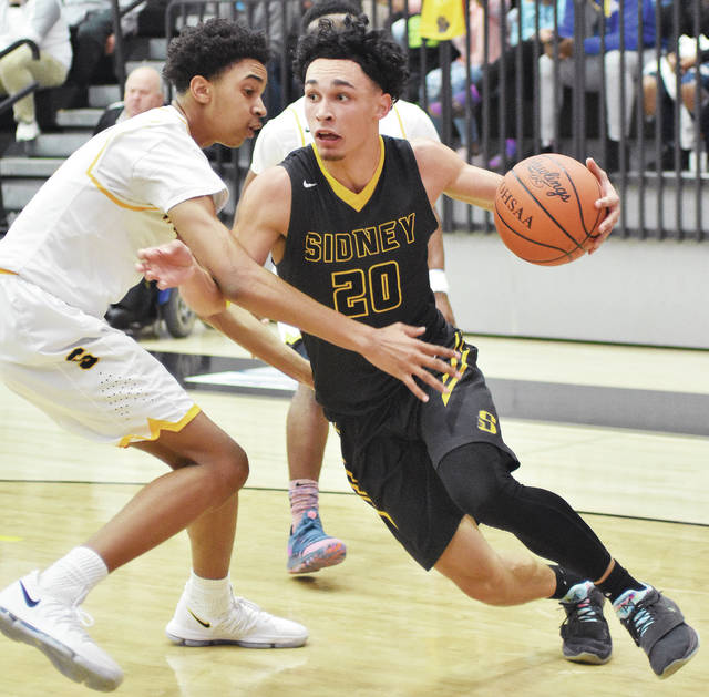 Sidney junior guard Andre Gordon drives with pressure from Springfield's Seth Towns during a Division I sectional final on March 2 at Centerville. Gordon was honorable mention all-Ohio in Division I.