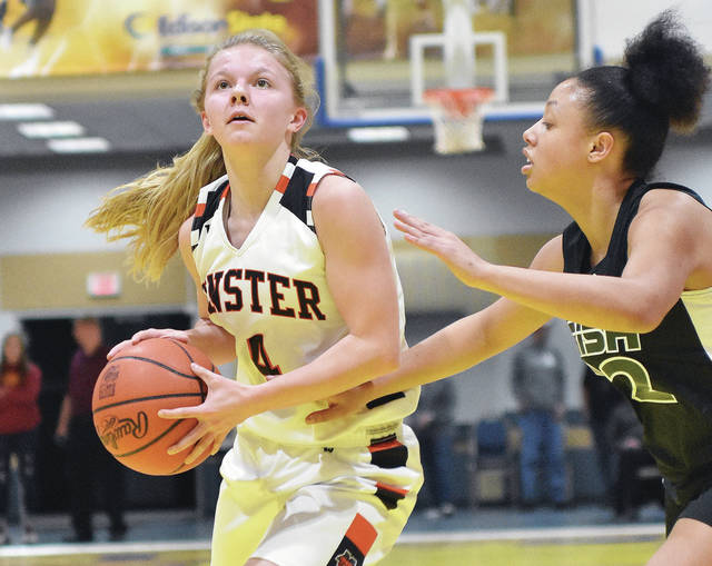 Minster's Ivy Wolf dribbles during the Bill Moss Underclass all-star game on Thursday at Edison State in Piqua. Wolf is one of four area players that participated in the event. Minster's Courtney Prenger, Fort Loramie's Marissa Meiring and Russia's Laurissa Poling also played. Botkins senior Sarah Bergman and Anna senior Macey Huelskamp were honored in-between games.