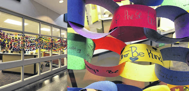 """On March 14, students at Sidney Middle School in grades 5 through 8 placed a personalized message of """"Hope to stop violence"""" on construction paper links. The messages were linked together to symbolize all their hopes coming together to stop the violence."""