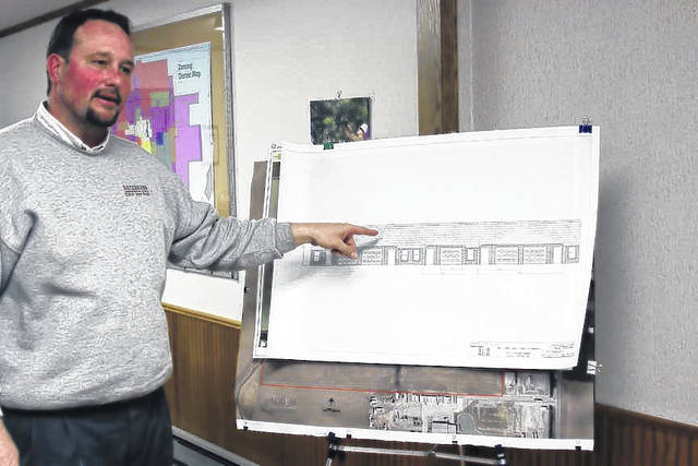 Todd Raterman, of Raterman Custom Home Builders, of Sidney, shows drawings of multi-unit housing to members of the Jackson Center Village Council, Monday, March 26.
