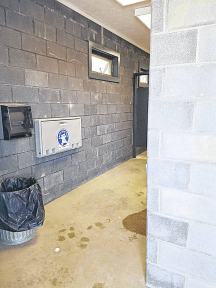A restroom in Four Seasons Park in Minster before Katherine Perryman, of Minster, painted it as part of a project to earn her Gold Award from Girl Scouts.