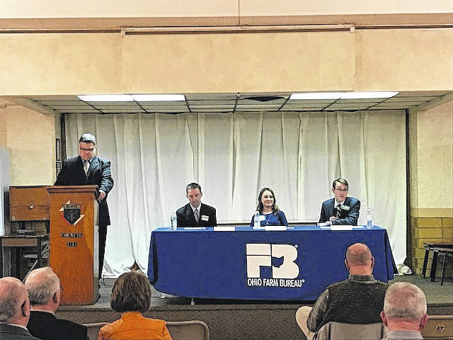 Tony Seeger, left, director of state policy for the Ohio Farm Bureau, moderates a question and answer session between Aaron Heilers (R-Anna), Susan Manchester (R-Waynesfield), and Travis Faber (R-Celina), right, during Thursday night's Candidate Forum at the Knights of Columbus hall in Minster.