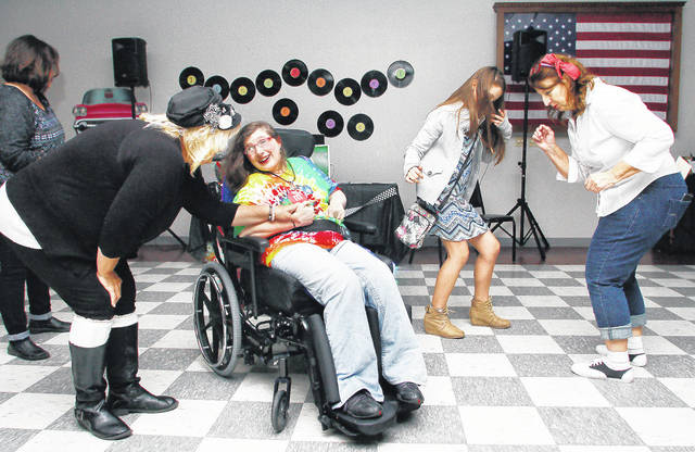 Partying at a November benefit for Alyssa Elliston, of Sidney, are, left to right, Linda Fridley, of Sidney, Jane Lehmkuhle, of Minster, Elliston, Skyla Kerns, 10, of Troy, daughter of Brittany Shellabarger and Nathan Kerns, and Elliston's mother, Connie Kerns, of Sidney. Another fundraiser will be May 5 at the Shelby County Fairgrounds. Proceeds will support experimental stem cell treatments for Elliston.