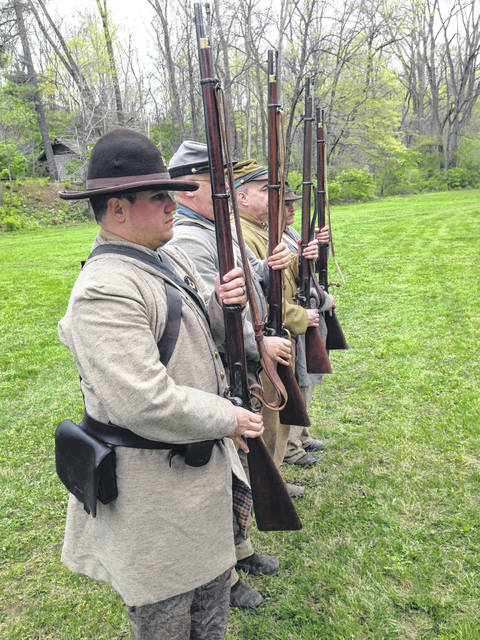 A few members of the 1st Tennessee Volunteer Infantry line up to begin drilling during their encampment last April at Brookside Park.