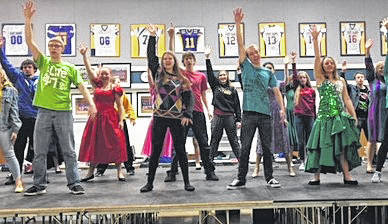 """Marion Local High School students rehearse a number from """"Footloose!"""" They will present the musical in the school gym, April 27-29."""