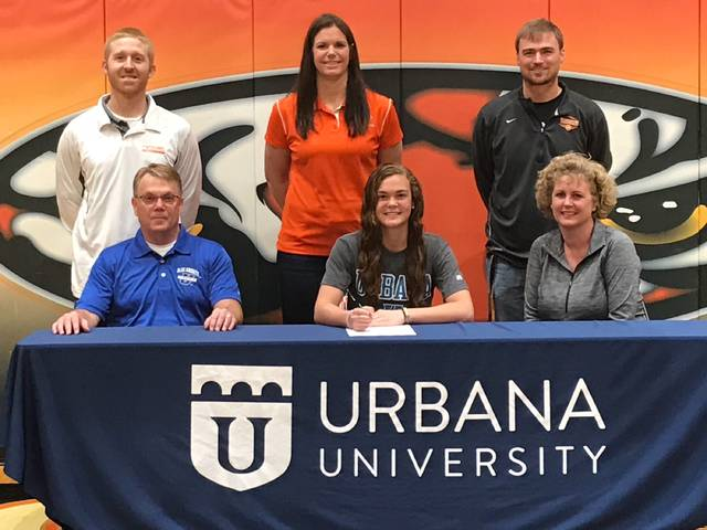 Versailles senior Kami McEldowney signed with Urbana University for basketball on Friday morning. Pictured are (front row, l-r) father Roger McEldowney, Kami McEldowney, mother Holly McEldowney, (back row, l-r) Versailles girls basketball assistant coach Brian Shappie, Versailles girls basketball head coach Jacki Stonebraker and Versailles Athletics Director Doug Giere.