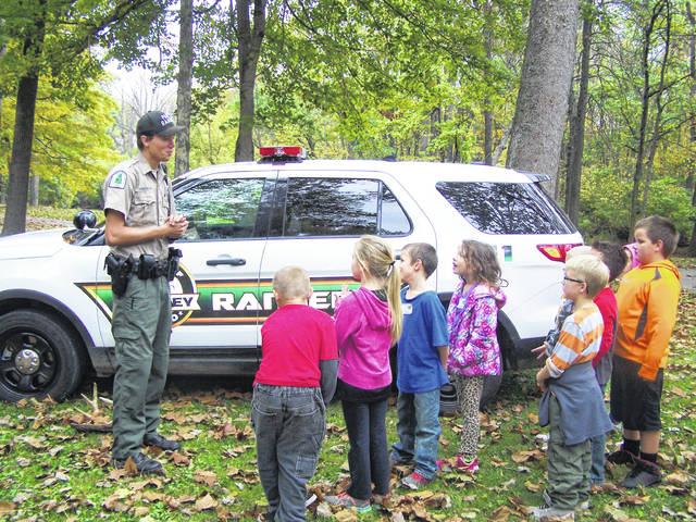 Sidney City Parks Ranger Justin Aselage, left, discusses nature in Tawawa Park for second-graders in 2016. He'll lead a nature walk and a stream study program during the park's 70th anniversary celebration, June 30.