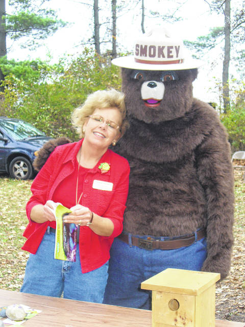 Lynda Adams and Smokey the Bear take a break during a recent Forestry Field Day.