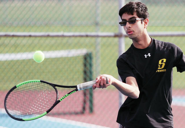 Sidney's Prem Dev runs up on a ball while playing against West Carrollton's Houston Fine during a No. 1 singles match at Sidney on Wednesday.