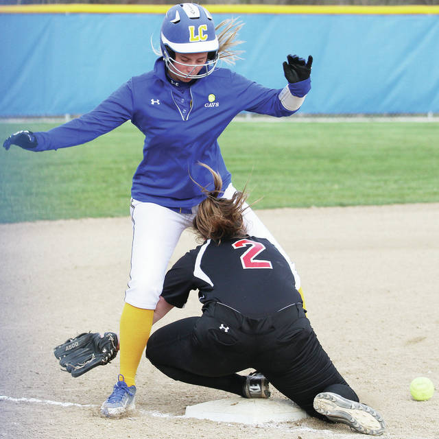 Lehman's Carly Edwards collides with Upper Scioto Valley's Briona Hurley at third base during a Northwest Central Conference game on Wednesday at Lehman.