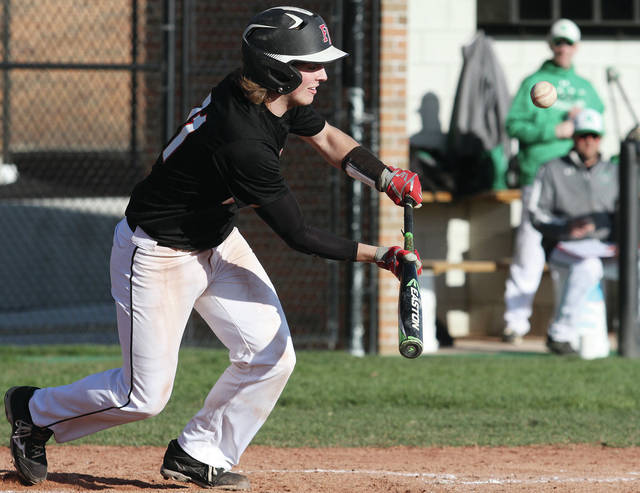 Fort Loramie's Carter Mescher bunts against during a Shelby County Athletic League game against Anna last Thursday at Fort Loramie. The Redskins broke a two-game SCAL losing streak with a 13-4 win over Botkins on Monday.