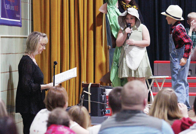 "Whittier Elementary music teacher, Jennifer Billing-Martz, left to right, of Anna, directs a production of ""Jack and the Beanstalk"" starring Ah'Niyah Wilson, 7, daughter of Brooke Lambert and Devin Wilson, and Collin Bowersock, 7, both of Sidney, son of Jennifer and Jammie Bowersock. The musical was Billing-Martz's last production. She is retiring at the end of this school year."