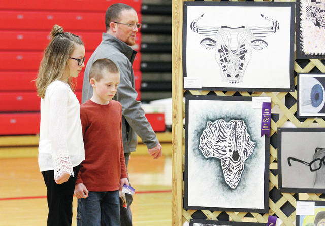 Attending the Hardin-Houston Art Show, are, left to right, Grace Koenig, 12, her brother Jackson Koenig, 10, and their father Mike Koenig, all of Houston. The art show was held Tuesday, April 24, followed by a Hardin-Houston Spring Concert 2018. The art show was organized by Hardin-Houston Elementary art teacher Sam Smith and high school art teacher Jill York.
