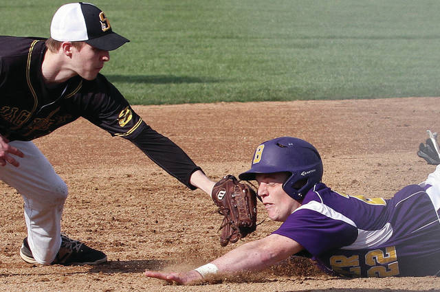 Sidney's Ryan Heins works to tag Butler's Karter Peck during a Greater Western Ohio Conference American North Division game on Wednesday in Vandalia.