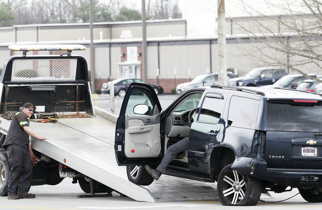 A black SUV is towed away after it pulled out into traffic where it and a red SUV collided, causing the black SUV to completely spin around in front of Subway on Michigan Street, Friday, April 27. The accident happened around 1 p.m.. The accident caused some traffic slowdowns.