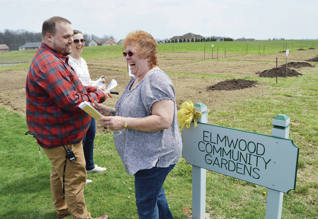 Sharing a laugh while looking over the new Elmwood Community Gardens are, left to right, Emilie Britton, of New Bremen, Elmwood Assisted Living Director of Administrative Services Chad Henning, of St. Marys, and Cheryl Brown, of New Bremen. Britton and Brown will be taking over plots in the garden. Britton will garden a plot by herself while Brown will be taking over a plot for her company Auglaize Indurstries which will make the plot open to all of their staff and employees. A grand opening of the garden was Friday, April 27. For information, call 419-977-2711, ext. 1200 or email chenning@elmwoodcommunities.com.