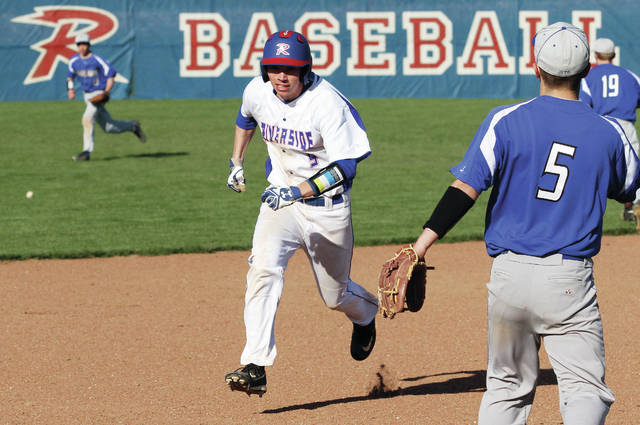 Riverside's Greg Bryant runs for third as Fairlawn's Jordan Lessing, left, runs towards the ball hit into left field during a nonconference game in DeGraff on Friday.