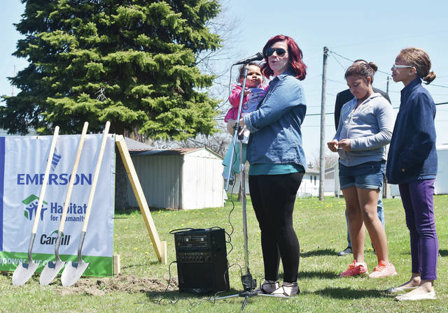 Kelly Beemer, left, to right, holding her daughter, Mylah Beemer, 1, speaks during a Habitat for Humanity groundbreaking for her family's future home. Standing with her are her daughters, Mikayla Huckleby, 11, and Kiana Huckleby, 9. The house will be built at 524 Second Ave. The groundbreaking was Sunday, April 29. Mikayla and Kiana are also the children of Michael Huckleby. Mylah is also the daughter of Terence Hudson.