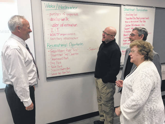 Sidney Public Works Director/Assistant City Manager Gary Clough, from left, enjoys a lighter moment during Sidney City Council's biennial retreat on Monday with Council members Joe Ratermann, center, Steve Wagner and Janet Born.