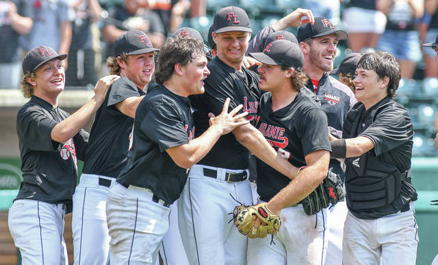 Fort Loramie's Hike Hoying, center left, and CJ Billing, center right, celebrate with Fort Loramie pitcher Jared Middendorf after a 2-1 win in a Division IV state semifinal on Thursday at Huntington Park in Columbus. The Redskins won 2-1 to earn a spot in Saturday's Div. IV title game.