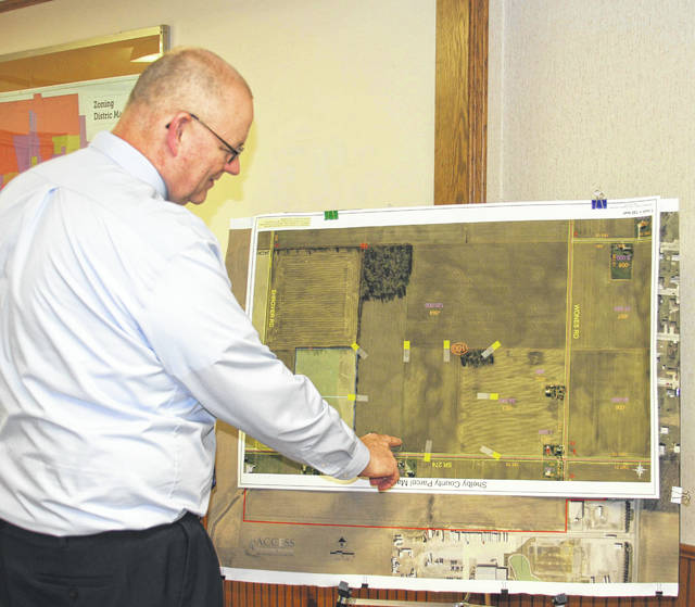 Jackson Center Village Administrator Bruce Metz points out recently annexed land that will have zoning changed from R-1 Residential to I-1 Industrial for the purpose of preparing for the proposed new Airstream Inc. manufacturing facility. His presentation was made at a previous council meeting.