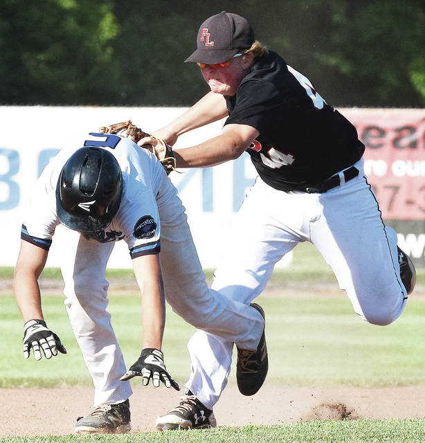 Fort Loramie's Shane Hilgefort chases down Cincinnati Christian's Jacob Carroll between second and third base during a Division IV regional final at Carleton Davidson Stadium on Friday in Springfield.