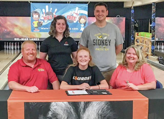 Last Thursday, Sidney's Jenna Beatty signed a letter of intent to bowl for Lourdes University in Sylvania, Ohio. Beatty, who qualified for the state meet earlier this year, will be studying early education. In front row from left to right is Kevin Beatty (father), Jenna Beatty and Michelle Beatty (mother). In back row from left to right are Torrie Bartalone (head coach at Lourdes) and Trent Knoop (head coach at Sidney).