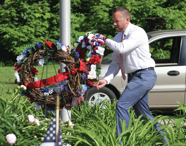 Wreaths are laid in honor of various veteran's groups during a Memorial Day ceremony at Graceland Cemetery.