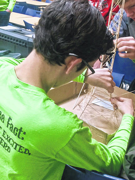 James Keller, left, and Austin Meyer compete in Towers during a recent regional Science Olympiad competition. The pair won 16th place at the state level, Saturday, April 28.
